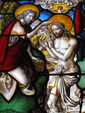 Baptism of Christ medieval stained glass window. The baptism of Christ  by John the Baptist, shown in an image on a medieval 16th century stained glass window Stock Photos