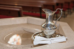 Baptism detail. (silver vessel with holy water Stock Photography
