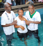 BAPTISM BY IMMERSION Stock Photo