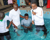 BAPTISM BY IMMERSION Stock Photos