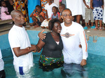 BAPTISM BY IMMERSION Stock Images