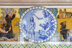 Baptism of Jesus. Crypt tiles showing Bible and St Benedict life. Royalty Free Stock Photography
