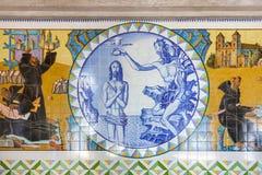 Baptism of Jesus. Crypt tiles showing Bible and St Benedict life. S. Bento da Porta Aberta, Portugal. April 06, 2015: Baptism of Jesus. Crypt tiles showing Royalty Free Stock Photography