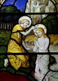 Baptism of Jesus in stained glass Stock Photo