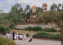 Baptism in the Jordan River. A group of people on the shores of the Jordan River to be baptized Stock Image