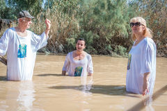 Baptism for pilgrims in river of Jordan, the place which is beli Stock Photo