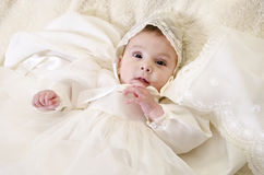 Baptism portrait. Little baby with ceremonial baptism clothes royalty free stock images