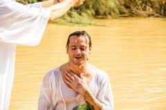 Baptism in a river of Jordan, Israel Stock Photos