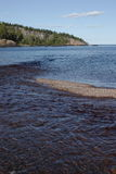 Baptism River Mouth. Baptism River flowing into Lake Superior with Shovel Point in the background - Tettegouche State Park stock photo