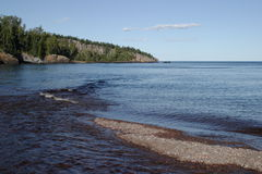 Baptism River Mouth. Baptism River flowing into Lake Superior with Shovel Point in the background - Tettegouche State Park royalty free stock photos