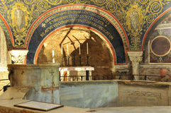 Baptismal font and altar. A 1600 year old ancient roman baptismal font and altar listed by UNESCO with original mosaics and inscriptions stock photos