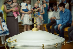 Baptismal font in the church. Yoshkar-Ola, Russia - Jule 17, 2015: People waiting for the baptism of children to the baptismal font in the church of the royalty free stock photos
