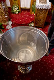 Baptismal font of holy water near altar Royalty Free Stock Photos
