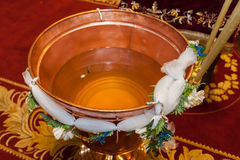 Baptismal font of holy water Stock Photography