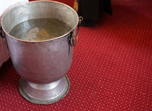 Baptismal font of holy water near altar Stock Image