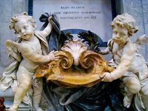 Baptismal Font at St Peter's Basilica, Rome, Italy. A pair of beautiful marble fonts for holding holy water and used in baptisms. It is found at the beginning of Royalty Free Stock Photography