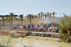 Baptisms in Jordan River Royalty Free Stock Photography