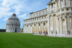 Baptistery and Cathedral in Pisa, Italy. Pisa, Italy - September 5, 2016: Battistero di San Giovanni baptistery and Cathedral in Pisa Italy. Unidentified people Royalty Free Stock Photography
