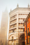 Baptistery and Duomo tower in Parma Stock Images
