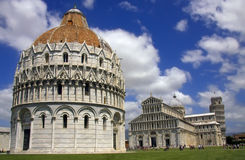 Baptistery and the leaning tower in Pisa Royalty Free Stock Images