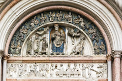 Baptistery of Parma, Italy. Relief above the portal Baptistery of Parma, Italy stock photos