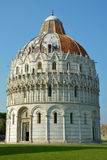 The Baptistery from Piazza dei Miracoli, Pisa, Tuscany, Italy. The Baptistery, dedicated to St. John the Baptist, stands opposite the west end of the Duomo. The Stock Photos