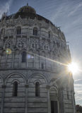 Baptistery of Pisa with blinding sun Stock Image