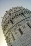 Baptistery of Pisa. The historic building in Pisa, Tuscany called the baptistery at sunset Stock Photos