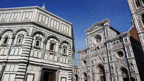 Baptistery of San Giovanni and the Basilica di Santa Maria del Fiore with Giotto campanile tower bell and Brunelleschi dome Royalty Free Stock Photography