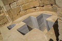 Baptistmal Cross Shaped Font in Avdat Ancient Nabataean Settleme. Nt Ruins, Negev desert ,Israel.UNESCO World Heritage site, In Hellenistic Period and early Royalty Free Stock Photography