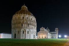 Baptistry, cathedral and leaning tower of Pisa at night Royalty Free Stock Photo