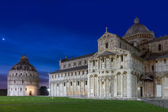 Baptistry and dome of Pisa after sunset, Tuscany, Italy Stock Image