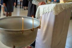 Baptizing in orthodox church Stock Photo