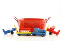 Baquet et jouets Photographie stock
