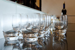 Bar. Several glasses isolated and iluminated by white dim light Royalty Free Stock Image