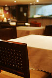 A bar. Ellipse table around by square chair in a bar Stock Photos