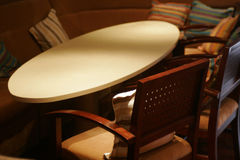 A bar. Ellipse table around by square chair in a bar Royalty Free Stock Images