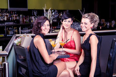 In the bar. Group of young women in the bar Royalty Free Stock Photos