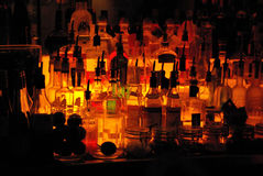 At the bar. A collection of spirits bottles at a night club bar, ready to produce any cocktail of your choice stock photos