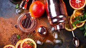 Bar accessories, drink tools and cocktail ingredients on rusty stone table. Flat lay style Royalty Free Stock Photos