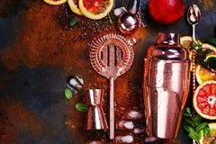 Bar accessories, drink tools and cocktail ingredients on rusty stone table. Flat lay style stock photos