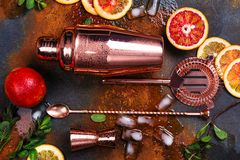 Bar accessories, drink tools and cocktail ingredients on rusty stone table. Flat lay style Stock Photography