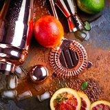 Bar accessories, drink tools and cocktail ingredients on rusty stone table. Flat lay style Stock Image