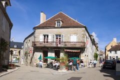 A bar in an ancient house on the path to top of Vezelay hill. Vezelay is a commune in Burgundy in France. The path to top of Vezelay hill and the cathedral of St royalty free stock photography