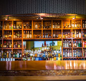 Bar with assorted alcohol and spirits Royalty Free Stock Photos