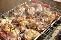 Bar-B-Q. Or BBQ with kebab cooking. coal grill of chicken meat skewers with mushroom and peppers. barbecuing dinner stock images