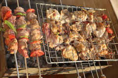 Bar-B-Q. Or BBQ with kebab cooking. coal grill of chicken meat skewers with mushroom and peppers. barbecuing dinner royalty free stock image