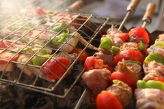 BBQ Grill and glowing coals. Bar-B-Q or BBQ with kebab cooking. coal grill of chicken meat skewers with mushroom and peppers. barbecuing dinner Royalty Free Stock Photography