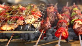 Grilling meat on barbecue grill-video full HD 1080. Bar-B-Q or BBQ with kebab cooking. coal grill of chicken meat skewers with mushroom and peppers. barbecuing stock video footage