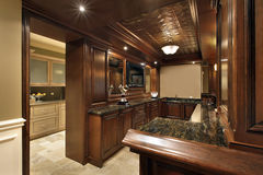 Bar in basement of luxury home Stock Images